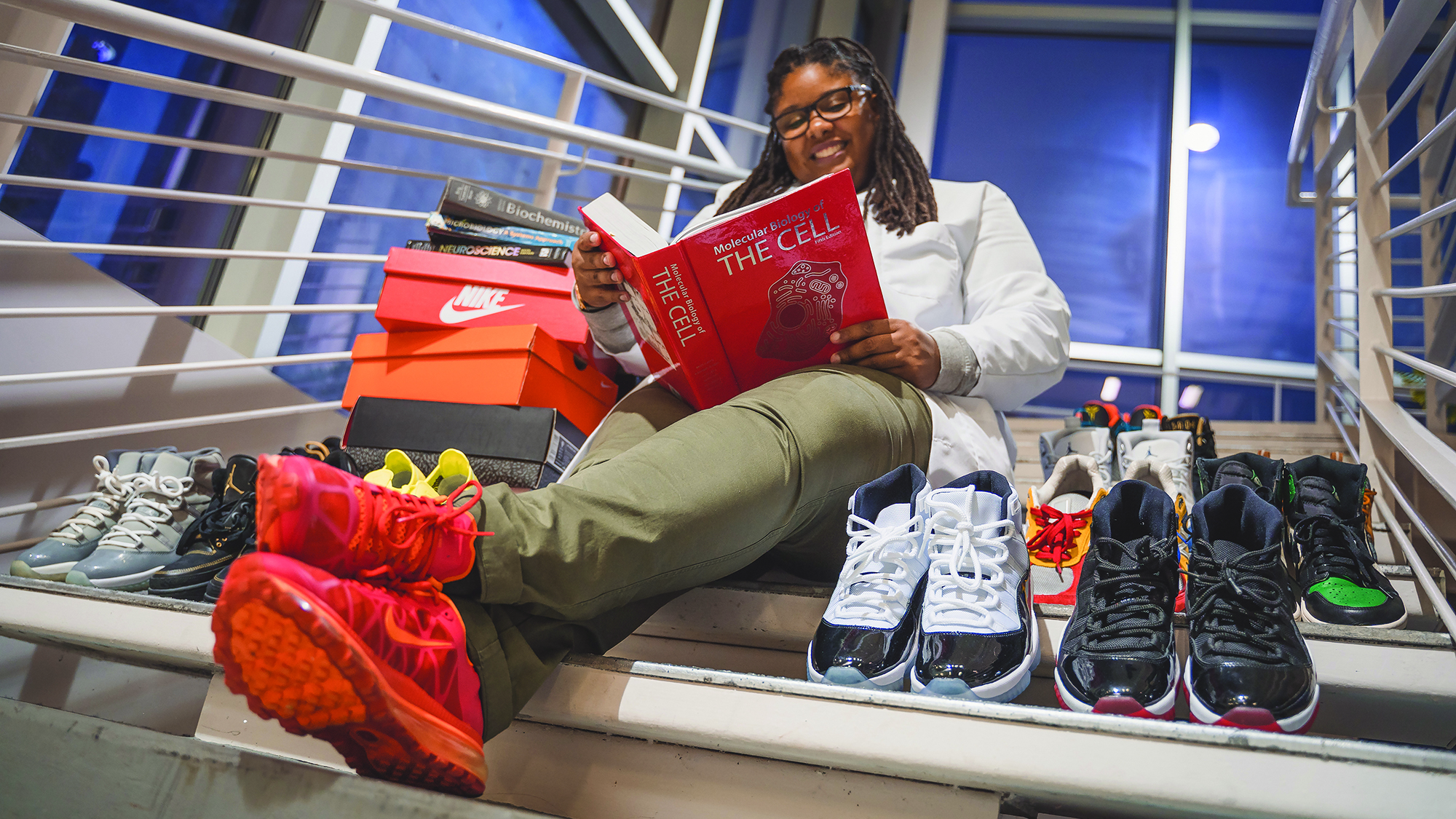 Kyla reading with sneakers
