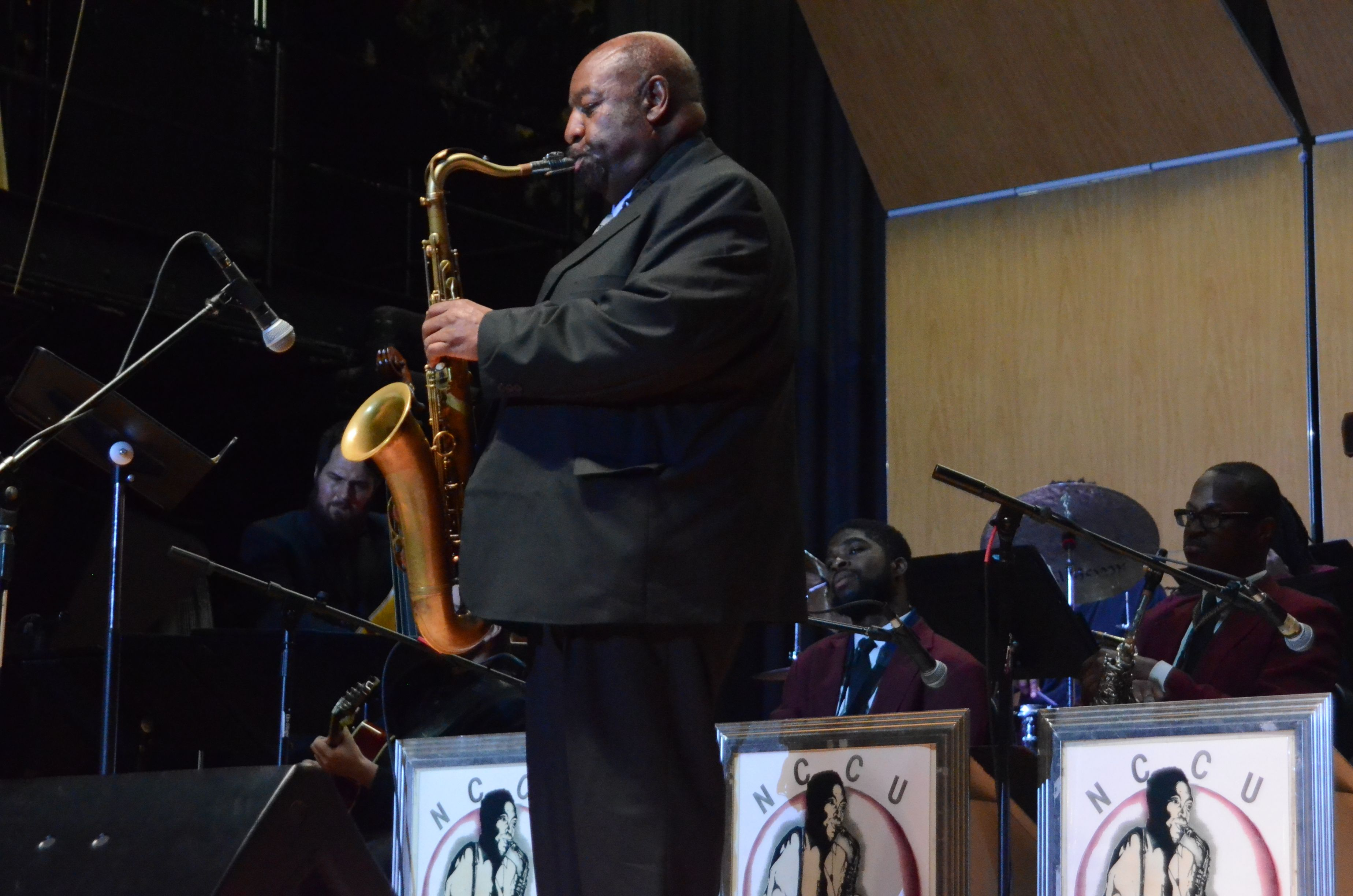Ira Wiggins playing his sax on stage