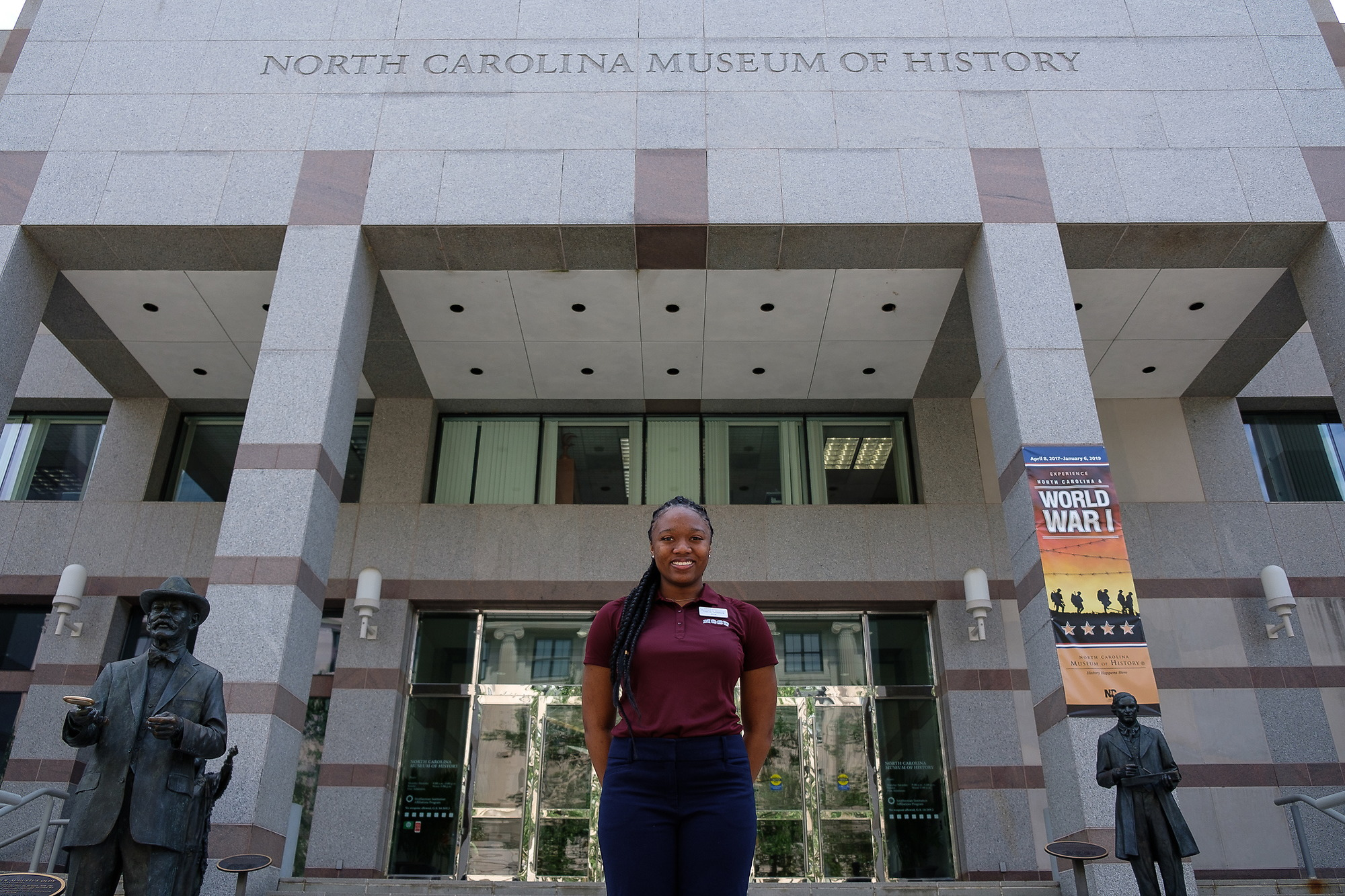 Student is standing in front of History museum