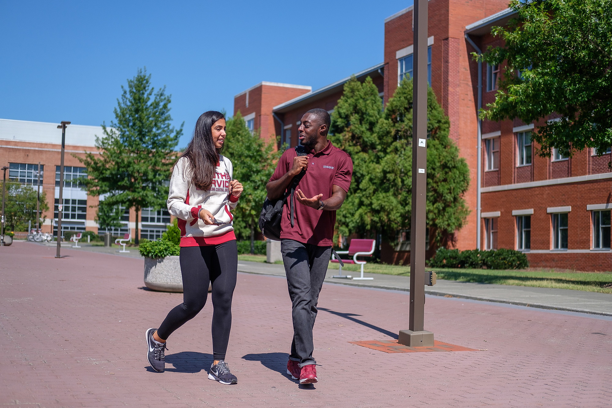 Transfered students are walking across campus
