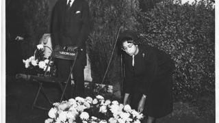 Carolyn Green Laying Wreath at Grave