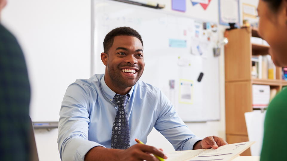 Student Smiling at a desk